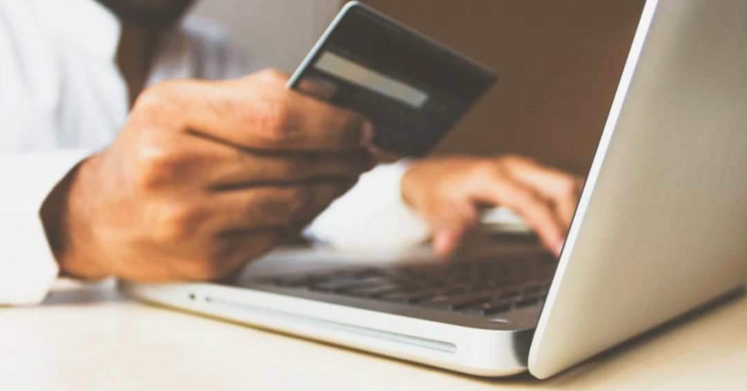 man using credit card to pay online