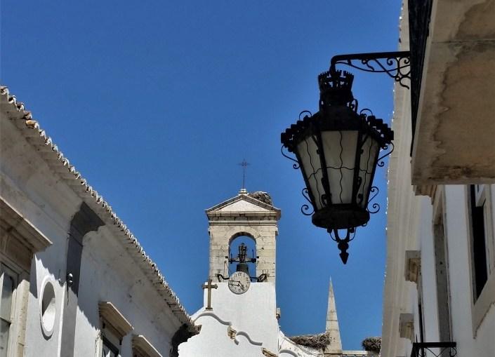 Faro old town gate with fado portuguese guitar