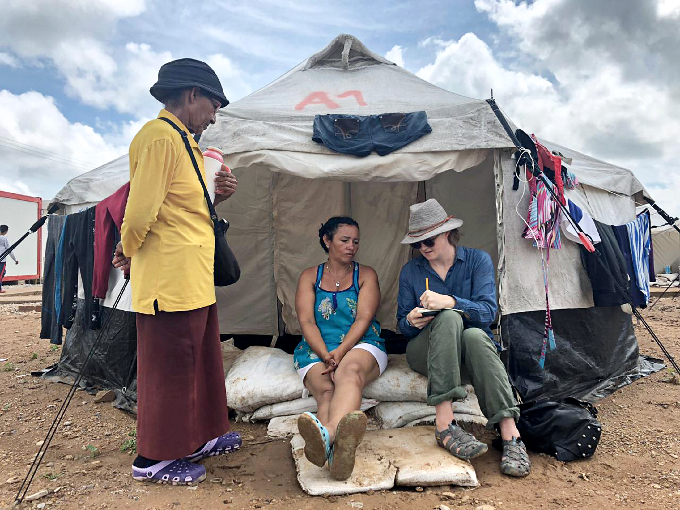 Laura Dixon interviewing two migrant women from Venezuela who were staying at a UN camp in Maicao, Colombia. Photo by Erika Pineros.