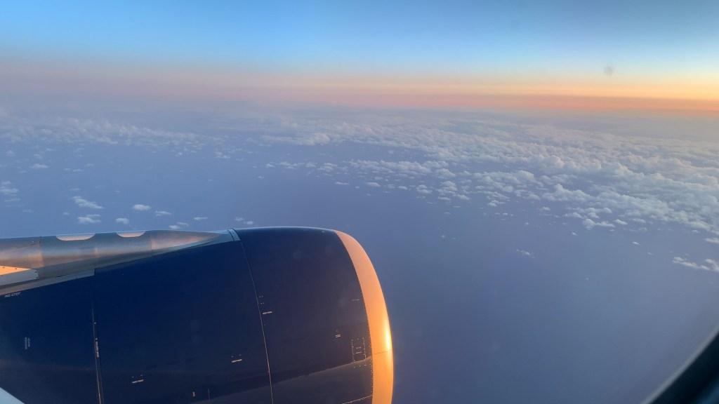 flying sunrise airplane engine