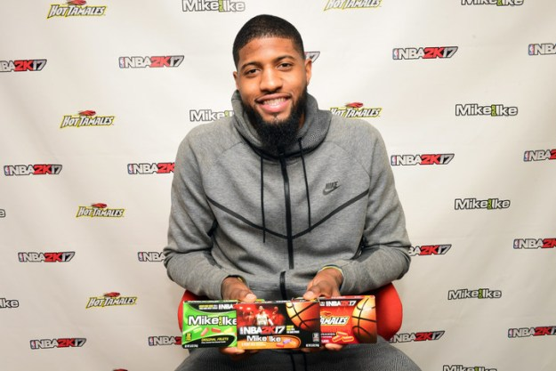 Four-time NBA All-Star and NBA 2K17 featured cover athlete, Paul George, introduces and autographs a new line up of promotional packages at basketball's big weekend on Friday, Feb. 17, 2017, in New Orleans, LA. Just Born Quality Confections and the MIKE AND IKE® and HOT TAMALES® brands partnered with 2K Sports and their leading sports video game, NBA 2K17. (Cheryl Gerber /AP Images for Just Born Quality Confections)