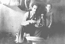 Mr. Mandil and his son Gavra while in hiding.