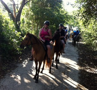 Horseback riding on Christmas Day - wish we could have taken photos of riding them into the surf