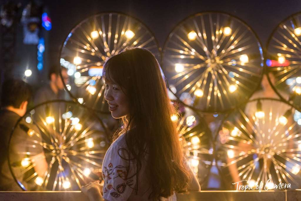 A woman lit against lights at a festival in Ho Chi Minh City, Vietnam