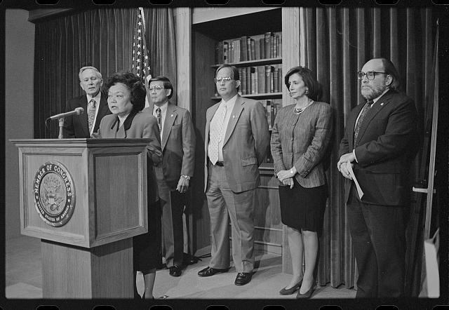 Patsy Mink became the first Asian American Congressional member in the 1960s; Laura Patterson, [Representative Patsy Mink announces the formation of the Congressional Asian Pacific American Caucus at a press conference with (left to right) Representatives Don Edwards and Norman Mineta, Guam Delegate Robert Underwood, and Representatives Nancy Pelosi and Neil Abercrombie], 1994, Roll Call portion of CQ Roll Call Photograph Collection, Prints and Photographs Division, Library of Congress