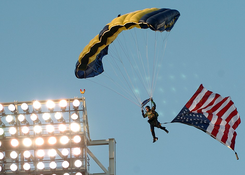 """050420-N-8977L-004 San Diego, Calif. (April 20, 2005) Ð A Member of the U.S. Navy Parachute Team, the """"Leap Frogs,"""" descends into San Diego's Petco Park as part of opening ceremonies for the San Diego Padres' Military Appreciation Day. The events preceded a game between the Padres and the Los Angeles Dodgers. U.S. Navy photo by PhotographerÕs Mate 2nd Class Johansen Laurel (RELEASED)"""