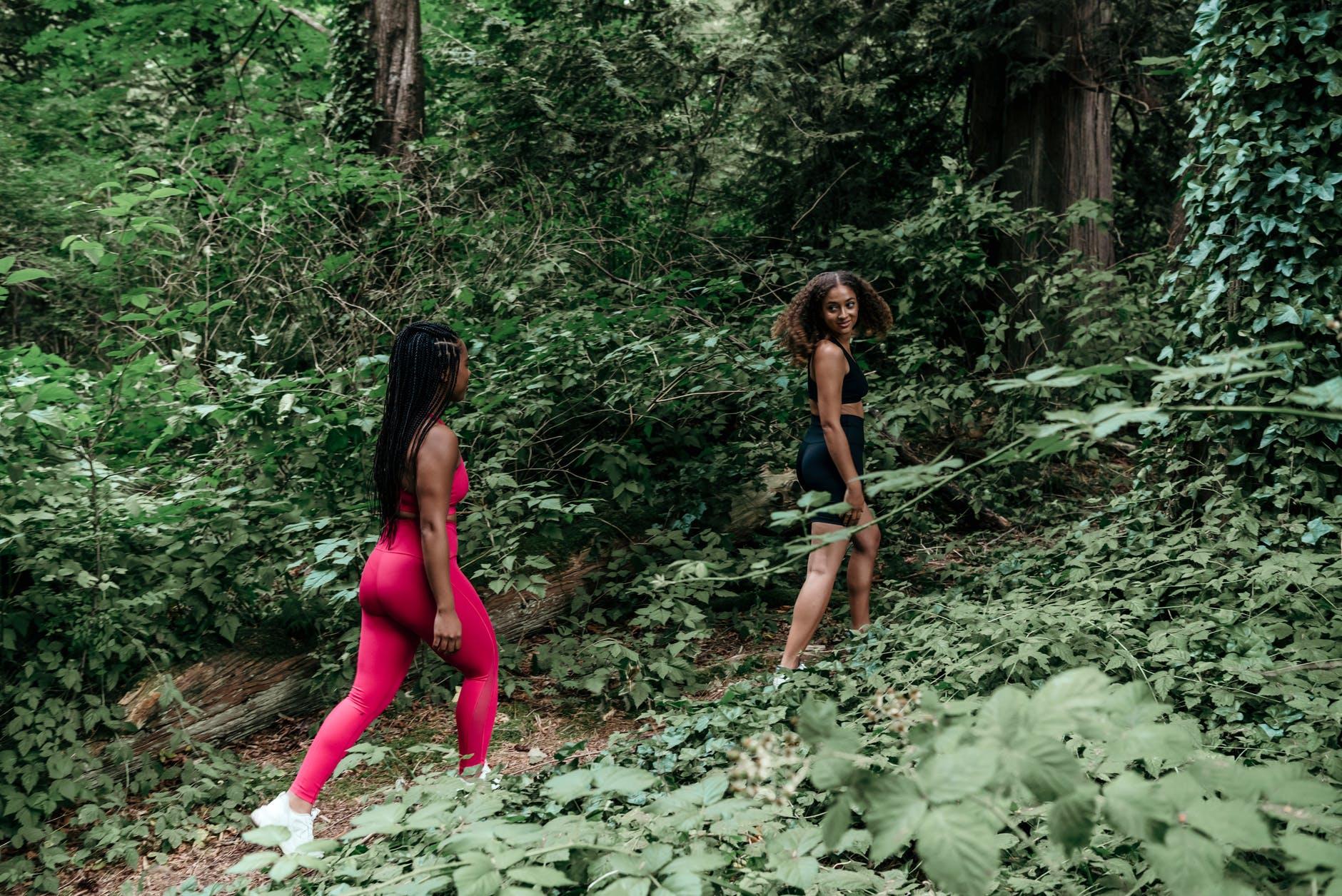 two friends walking in a forest