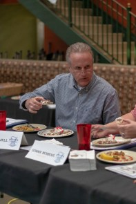The judges tasted the food and then scored it based on several categories.
