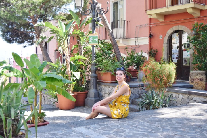 The yellow playsuit in the colorful Milazzo.
