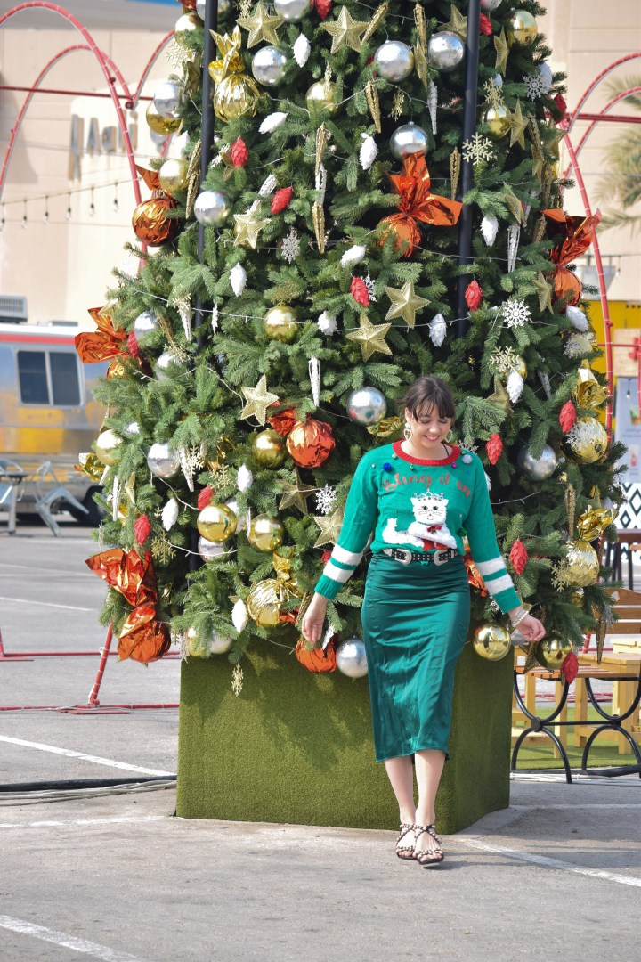 Chic with a christmas sweater.