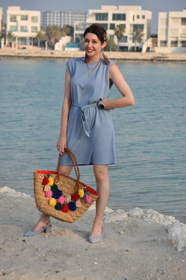 A blue sky dress with multicolors accessories