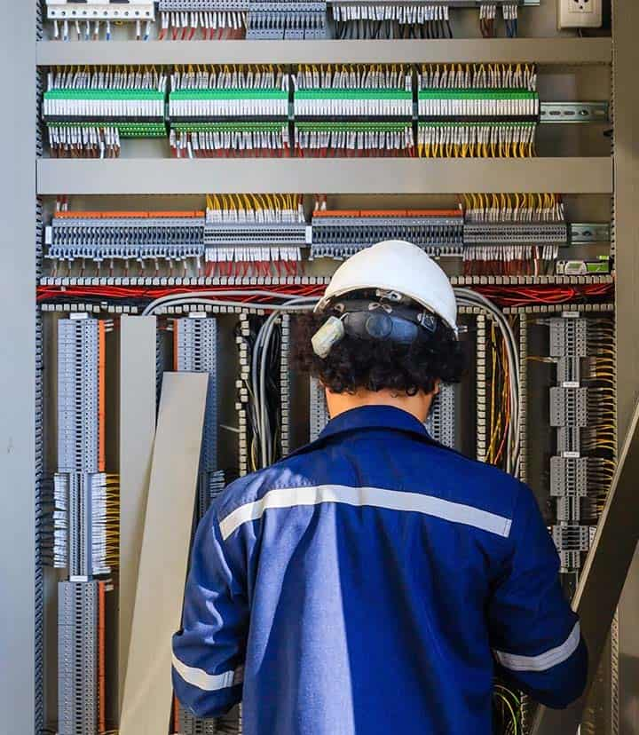 Electrician Checking the Electrical Panels