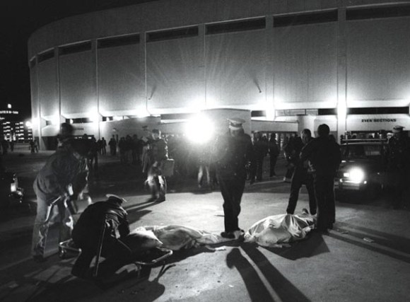 Bodies of concertgoers lie on the Coliseum plaza December 3, 1979 after 11 died in the crush before a concert by the Who.