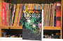 Dungeon World cover, in front of bookcase