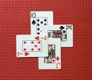 Four overlapping playing cards