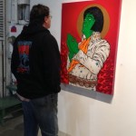 Kris Mikkelson with Elvis painting by Chris Shaw
