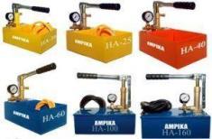 Фото: установка для гидравлических испытаний отопительных систем трубопроводов - ручные насосы