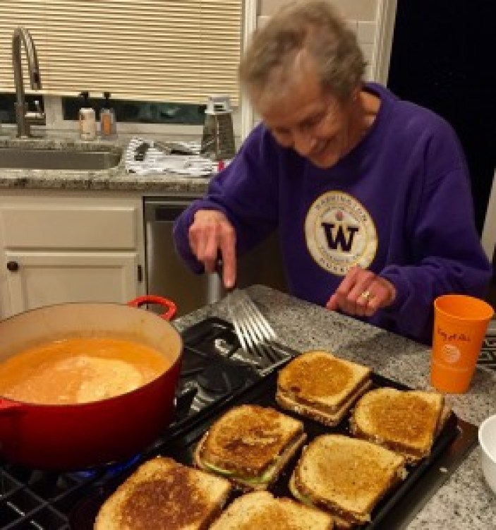 Devoted Husky fan warming up homemade tomato soup and grilling sandwiches--love you Mamma Bo