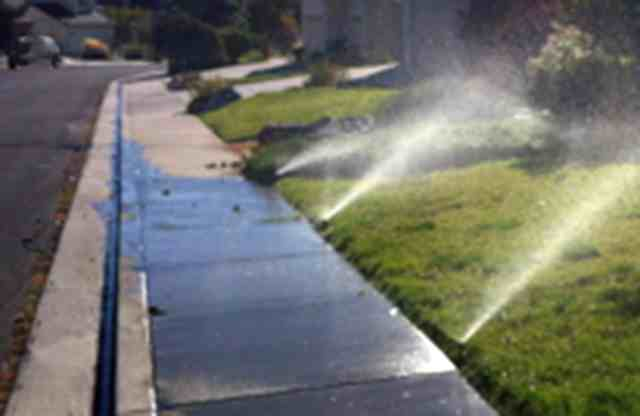 Water runs off over-irrigated lawn in Reno