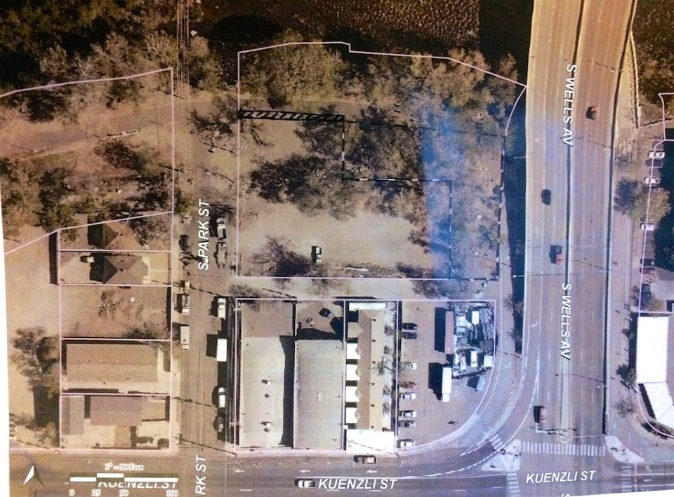 Overhead view of property (right-most parcel outlined in white) to be transferred to developers for a new apartment complex.