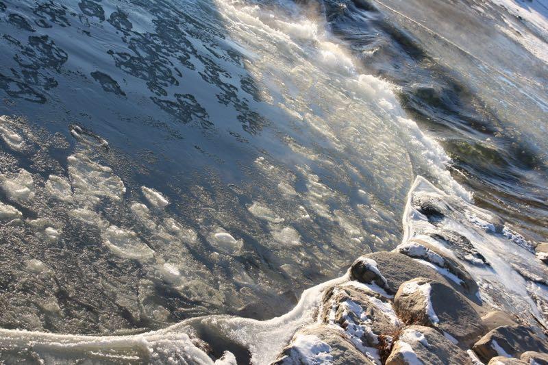 Flowing ice. Truckee River, Reno.