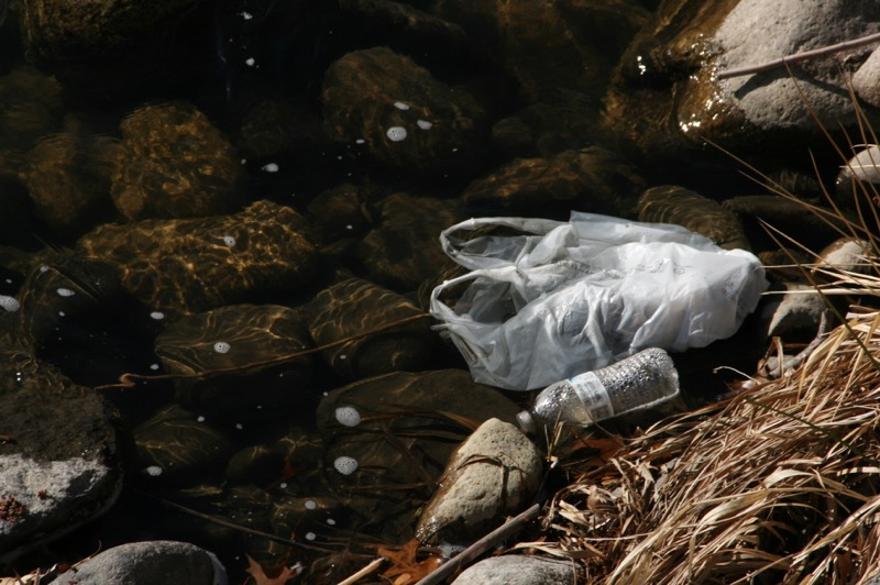 Bags and bottles in the river channel, downtown Reno. March 5, 2015.