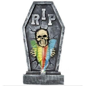 Lápida de cementerio con las siglas RIP y esqueleto luminoso de Barullo