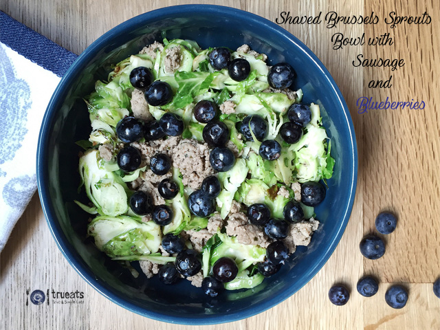 shaved brussels sprouts bowl with sausage and blueberries