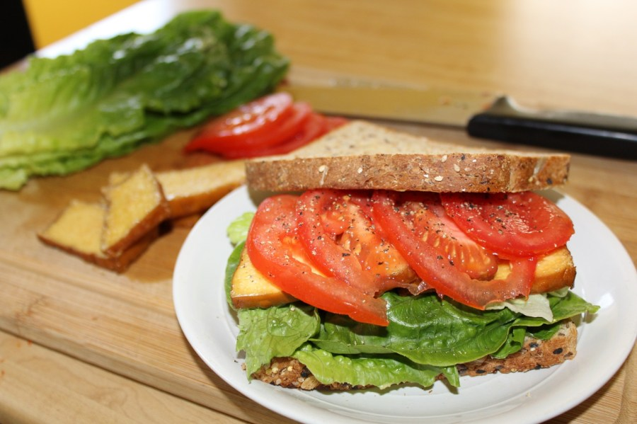 """Vegan BLT or a """"TLT"""" sandwich with smoked tofu, fresh lettuce, fresh tomato and lightly toasted bread."""