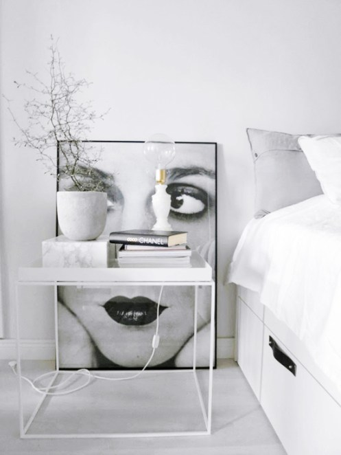 Beautiful-bedroom-with-art.-bed-interior-decor-decoration-book-chanel-table-side-minimalist-woman-portrait-black