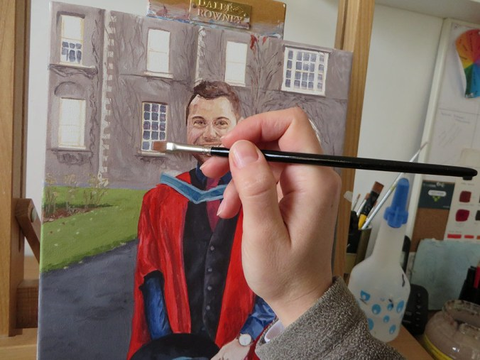 colour blocking a painting of a graduate