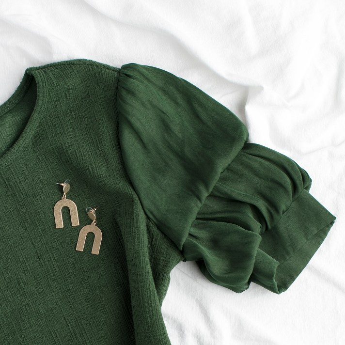 green sweater with puff sleeves and gold u-shaped earrings for casually dressed personal styling