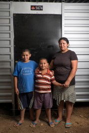 Maria and her boys Brayan & Elias in front of their new house.