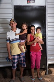 Jose & Maria with their children Liliana and Aide in front of their new home!