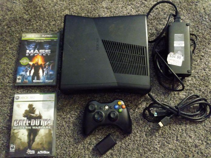 Xbox 360 4GB Slim Console 2 games 1 control cords. Works, GameStop refurbished