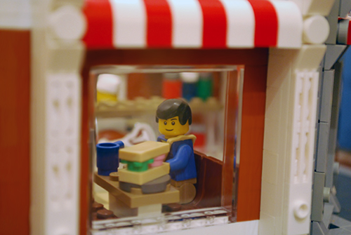 The booth as seen through my LEGO Corner Deli Window.