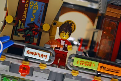 Kai enjoying a croissant in LEGO Ninjago City.