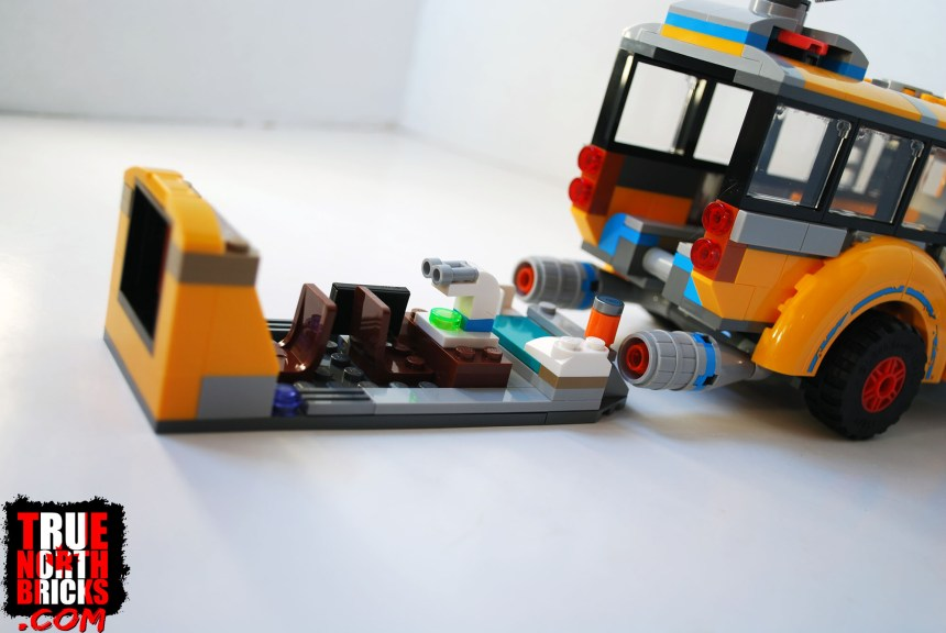 The rear section of the bus slides out.