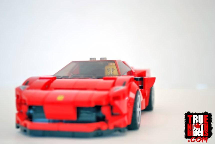 A bald Minifigure in the Ferrari F8 Tributo.