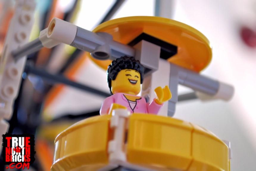 Fun Fair (60234) Minifigure on the Creator Expert Ferris Wheel.