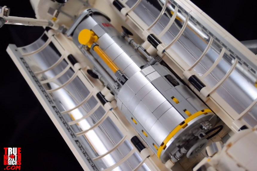 The Hubble Space Telescope stows in the Space Shuttle Discovery (10283) cargo bay.