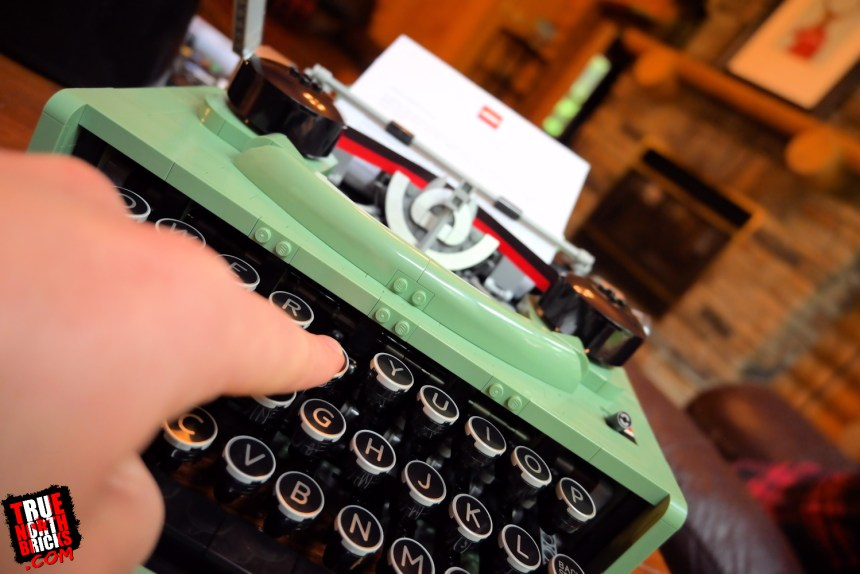 Pushing keys on the LEGO Ideas Typewriter (21327) causes lots of parts to move.