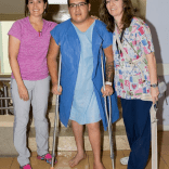 Patient J. D. - Physiotherapists Tanya Frizzell and Nonnie Arthur with a patient who walked stairs with crutches and is ready to go home.