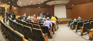 Medical professionals gather for discussion before setup.