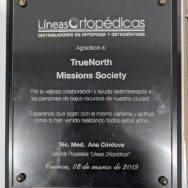 "TNMS was presented with a plaque from a Cuenca orthopedic supply business. Translated the plaque reads ""For the valuable collaboration and interested help to the low income people of our city. Hoping that they continue with the same charisma and attitude as they have been doing all these years."""