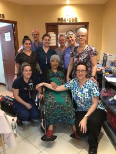 Nurses and patient porter, Trish MacPhail, pausing for a photo with a patient.