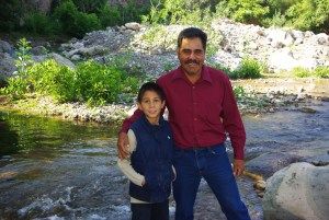 Patricio and his son Abraham by the creek