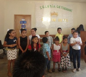 The kids sang to fathers at Getsemani Church.