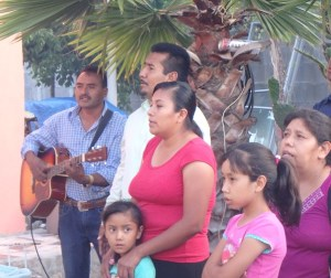 Juan (Sandra's husband, left) lead a song honoring Sandra on her birthday.