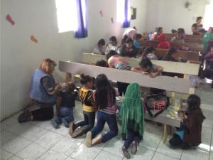 The kids used the church benches as tables during craft time.